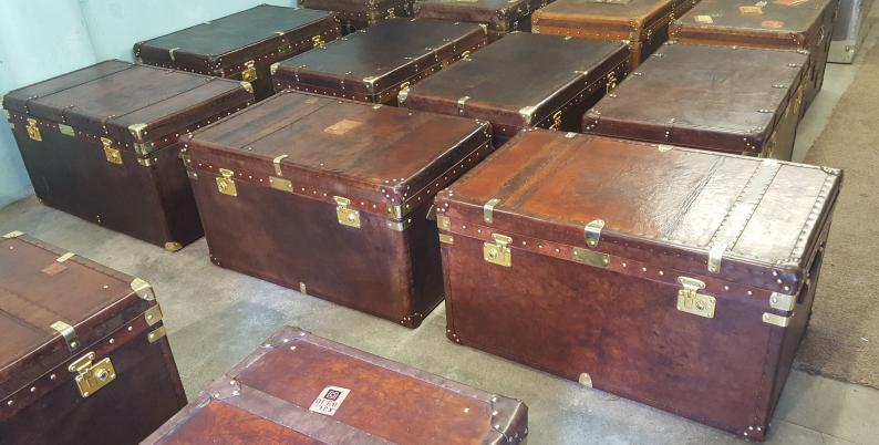 Coffee Table Trunks With Vintage Luggage Labels And Additional Brass Plaques